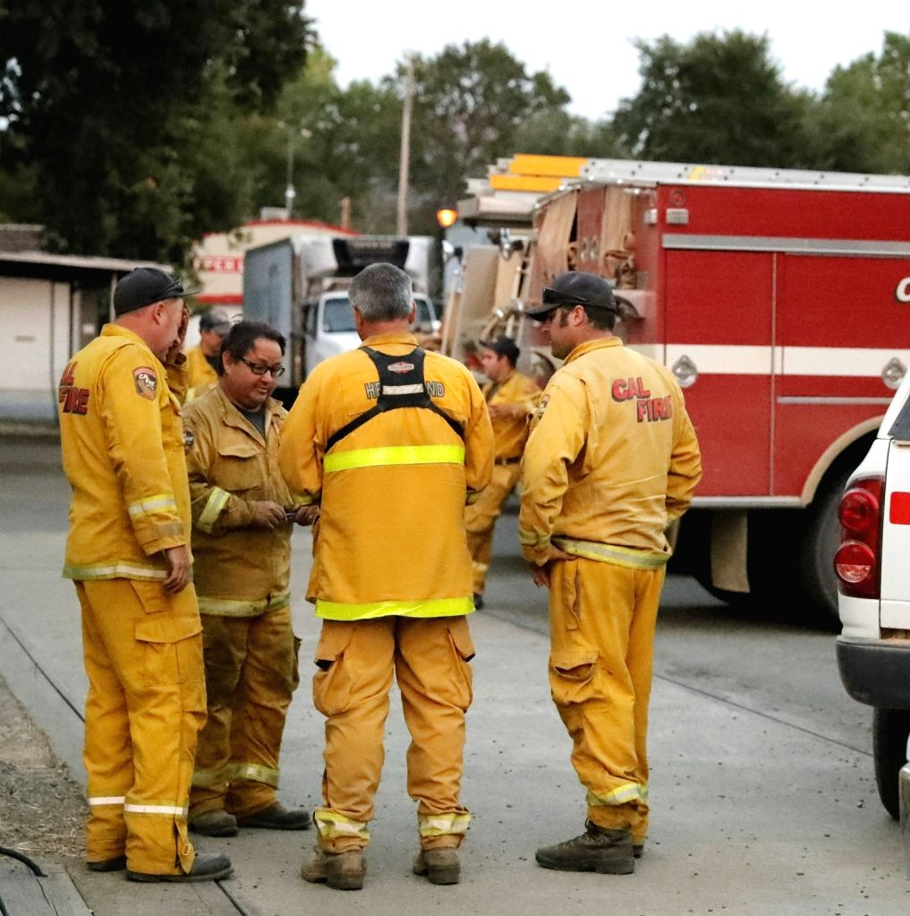 LAKE COUNTY, Aug. 11, 2018 - Firefighters stand by in Lake county where a wildfire swept through, California, the United States, on Aug. 9, 2018.