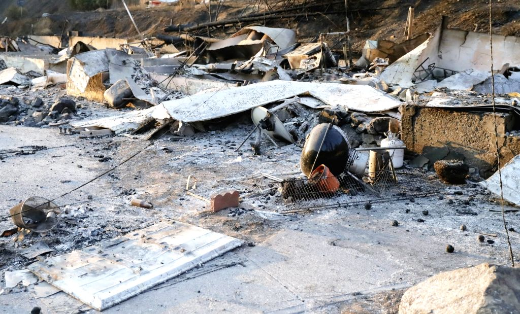 LAKE COUNTY, Aug. 11, 2018 - Wreckage is seen after being burned by a wildfire that swept through Lake county, California, the United States, on Aug. 9, 2018.