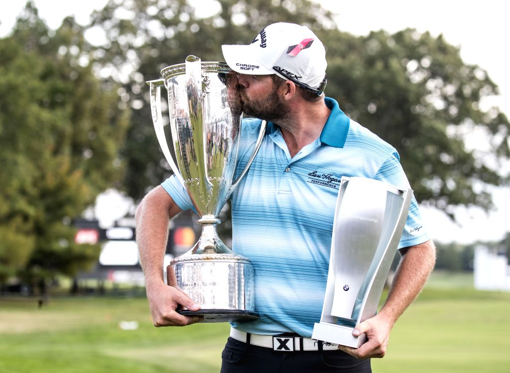 LAKE FOREST, Sept. 18, 2017 - Marc Leishman of Australia kisses the Wadley Trophy and holds the BMW Championship Trophy after winning the BMW Championship golf tournament at Conway Farms Golf Club in ...