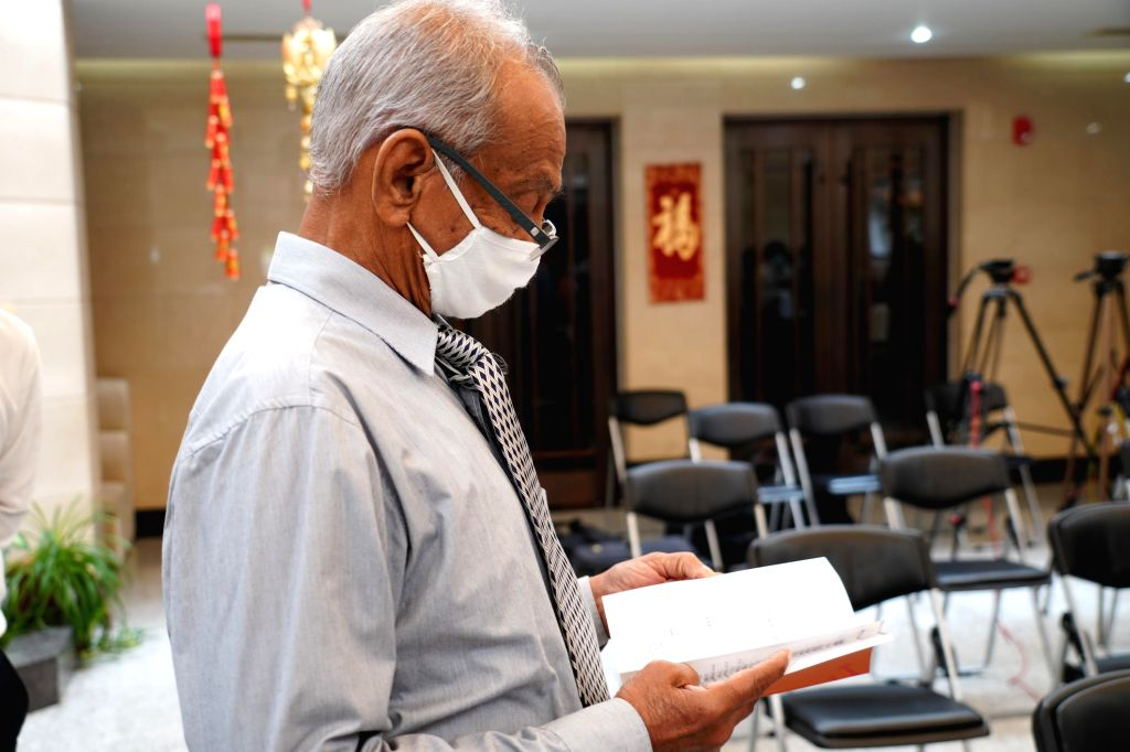 """Lakshmana Saparamadu, the translator of the Chinese book """"Prevention and Control of COVID-19,"""" attends a launch ceremony of the book in Colombo, Sri ..."""