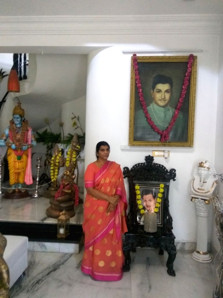Lakshmi Parvathi at her house in Hyderabad in front of NTR's portraits and statue.