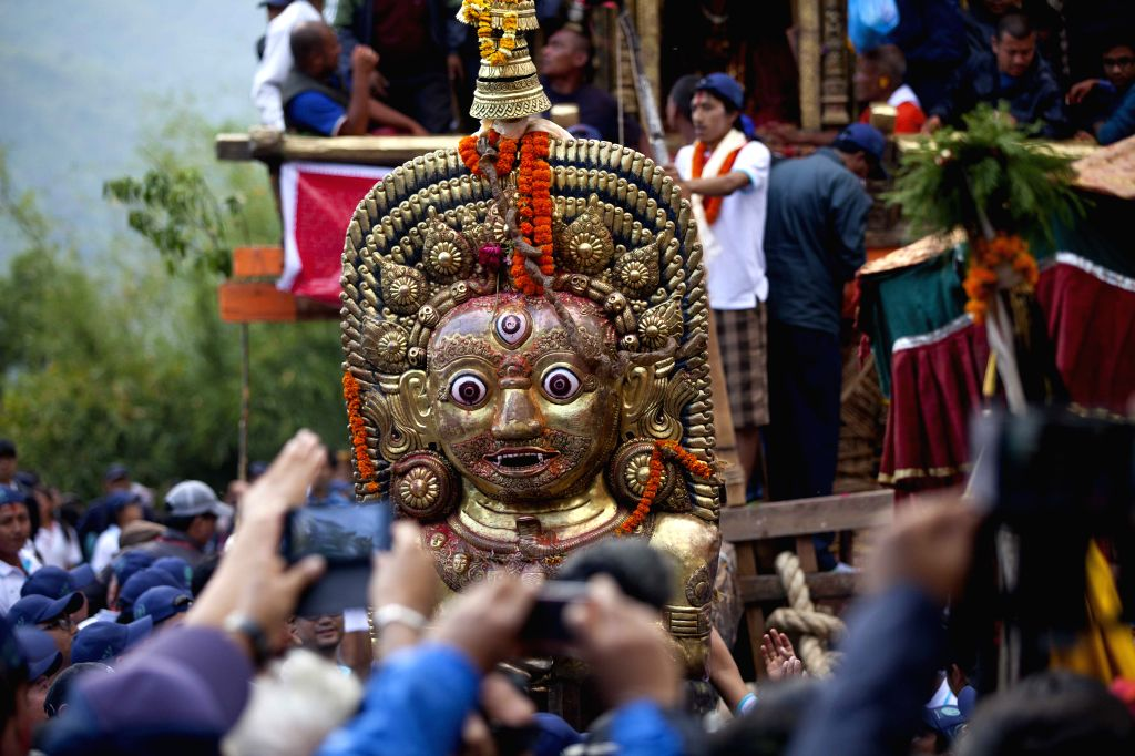 A statue of Lord Bhairav is seen in  front of chariot of Rato Machhendranath during the Rato Machhendranath festival at Bungamati in Lalitpur, Nepal, April 22, ...