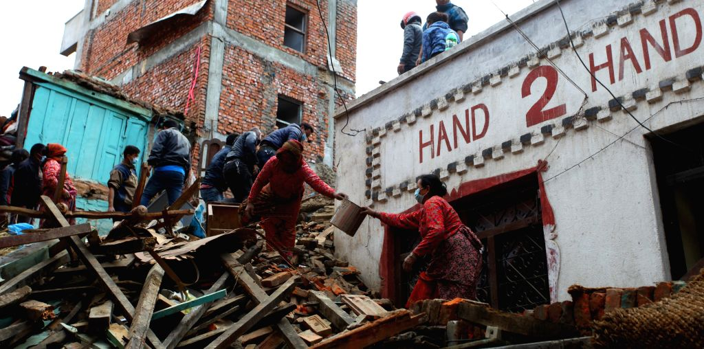 People remove the debris after earthquake in Lalitpur, Nepal, April 29, 2015. The 7.9-magnitude quake hit Nepal at midday on Saturday. The death toll from the ... - Sunil Sharma