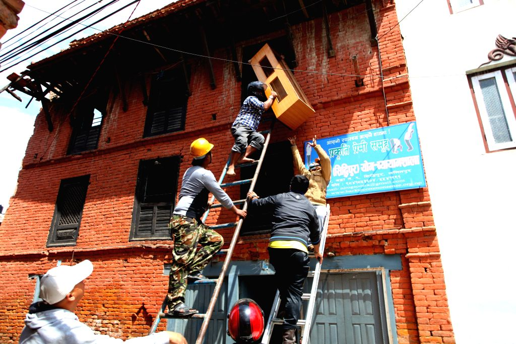 People take out belongings from damaged buildings after earthquake in Lalitpur, Nepal, April 29, 2015. The 7.9-magnitude quake hit Nepal at midday on Saturday. ...