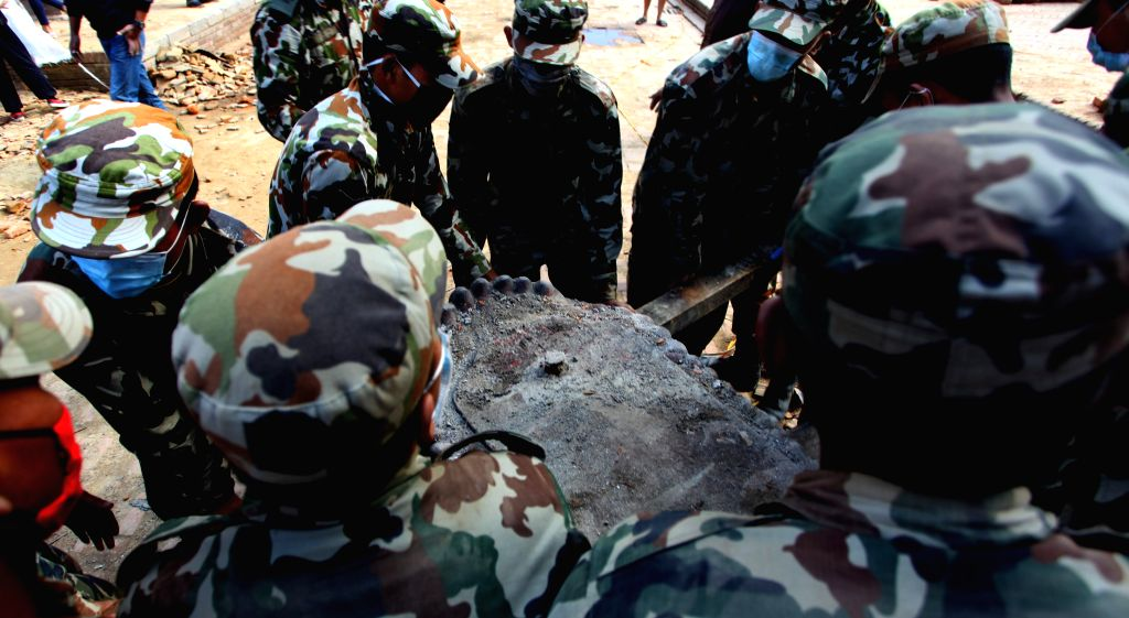 Rescue team of Nepal Army carry ancient monuments from the ruins of a temple after an earthquake in Lalitpur, Nepal, April 29, 2015. The 7.9-magnitude quake hit ...