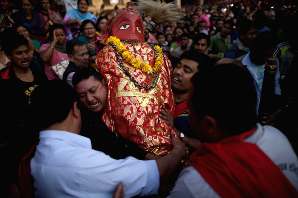 Devotees carry an idol of Rato Machhindranath during the Rato Machhendranath festival at Bungamati, Lalitpur in Nepal, April 5, 2015. Rato Machhindranath is known ...