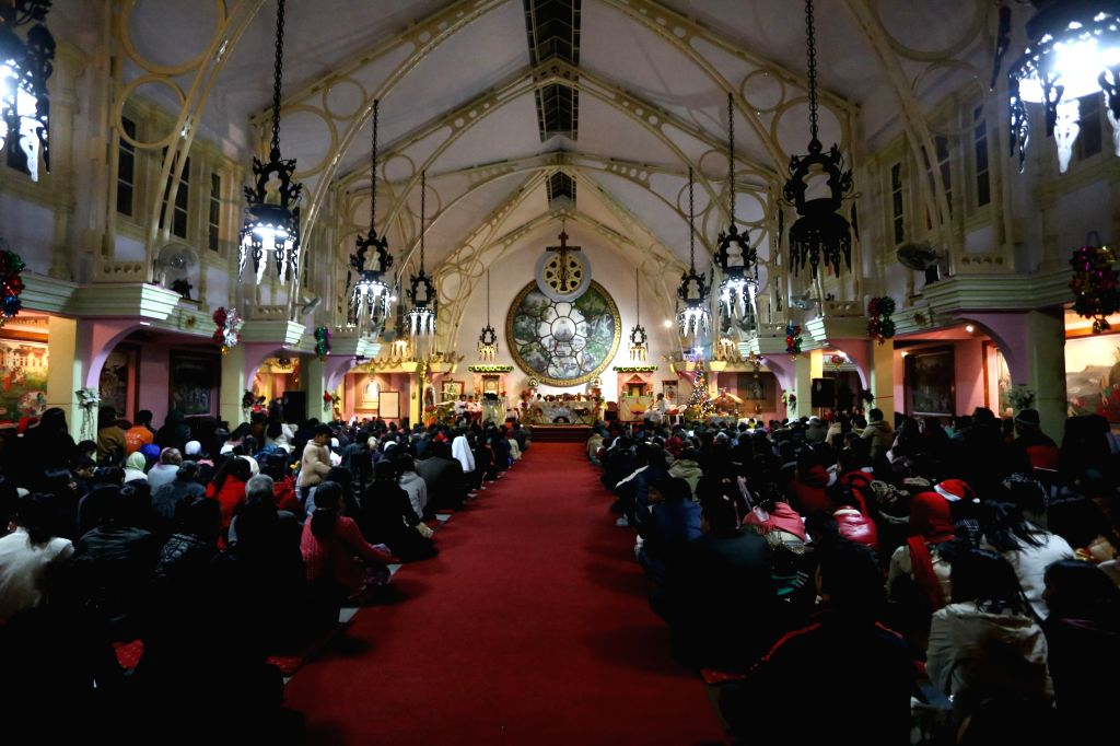 LALITPUR, Dec. 25, 2016 - People pray on Christmas Eve at a church in Lalitpur, Nepal, Dec. 24, 2016.