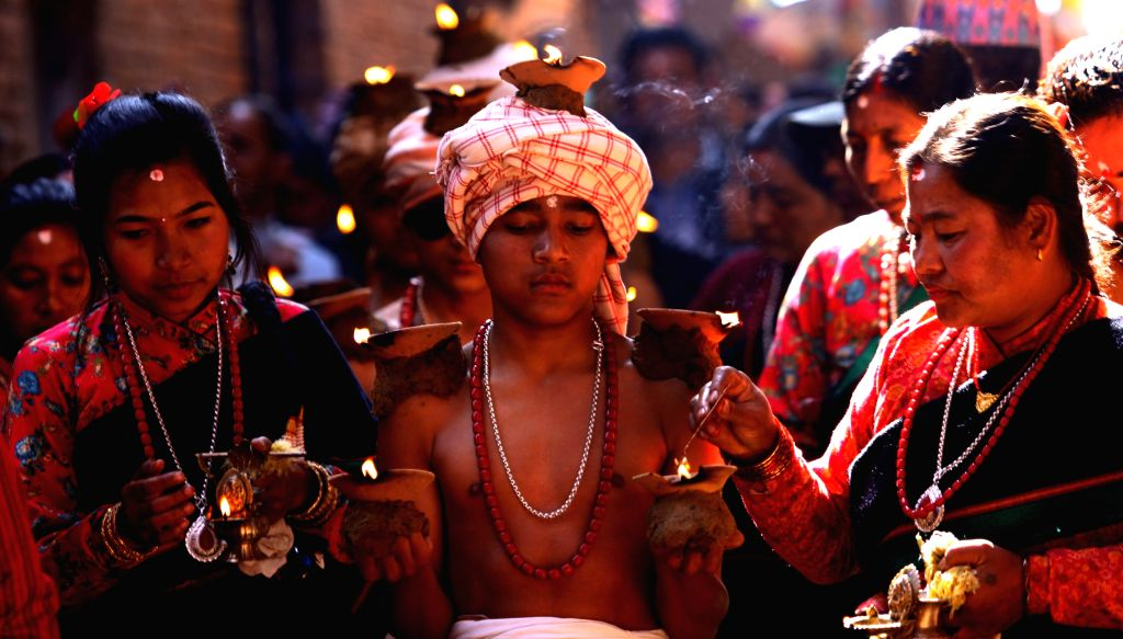 Nepalese Hindu devotees carry oil lamps on their body parts during the Madhav Narayan festival celebration in Thecho, Lalitpur, Nepal, Jan. 31, 2015. Nepalese Hindu