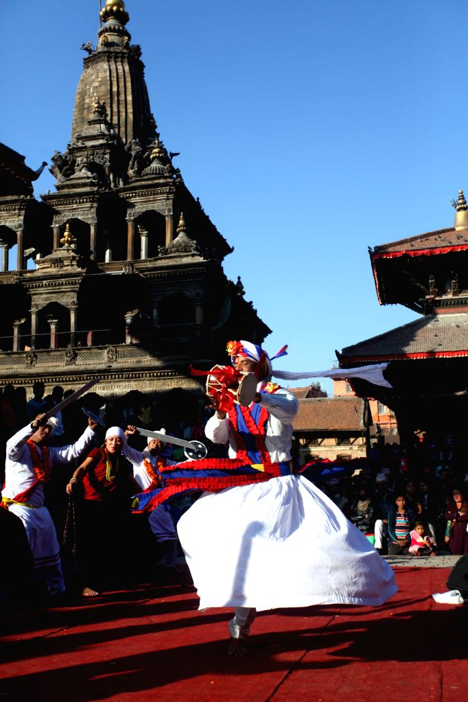 A boy performs traditional dance during the Dabali Yatra organized by Nepal Academy of Music and Drama at Patan Durbar Square in Lalitpur, Nepal, Jan. 10, 2015. ...