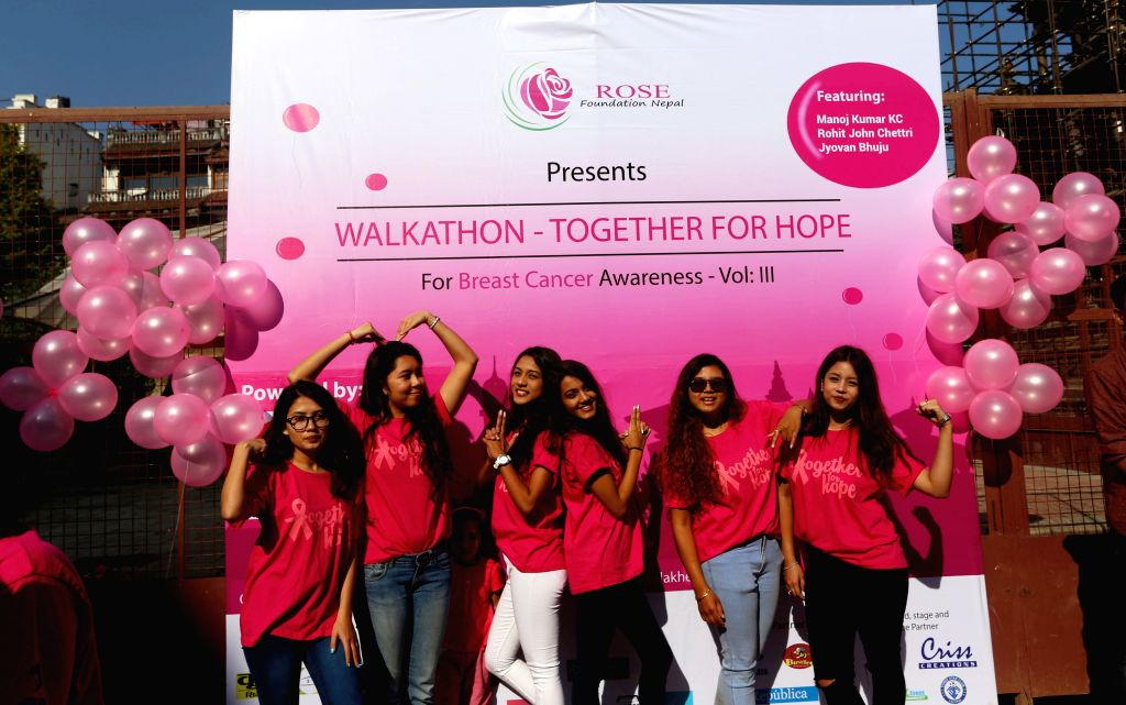 """LALITPUR, Oct. 22, 2016 - Nepalese girls pose for a photo as they participate in a walkathon titled """"Together for Hope"""" organized as part of a Breast Cancer Awareness campaign at ..."""