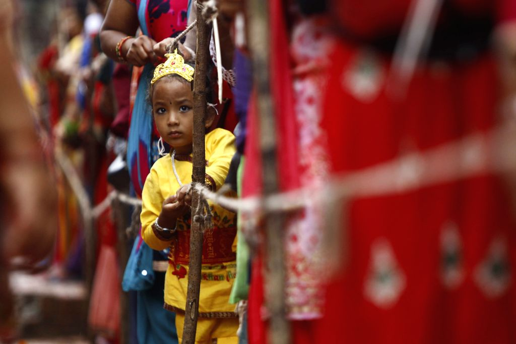 LALITPUR, Sept. 2, 2018 - A kid adorned as Lord Krishna is pictured while Hindu worshipers line up to celebrate Krishna Janmasthami festival in Laltipur, Nepal, on Sept. 2, 2018.