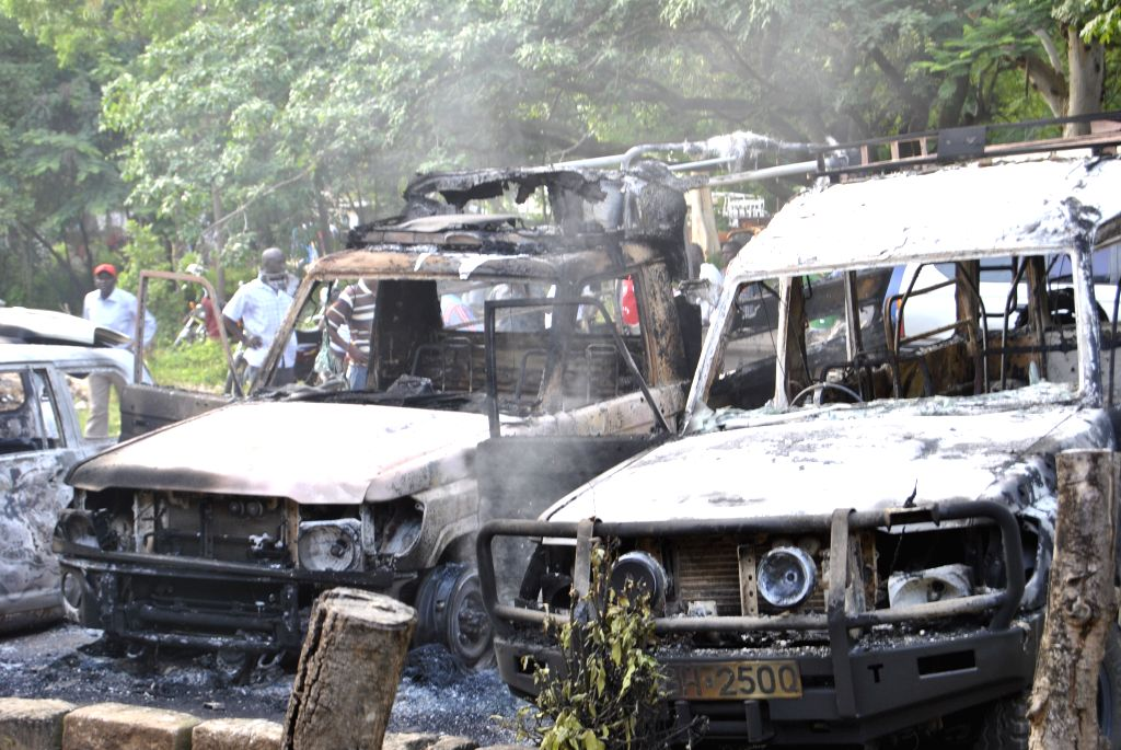 Photo taken on June 16, 2014 shows burnt government vehicles at Mpeketoni, a coastal town in Kenya. According to Kenya's Red Cross, at least 48 people died in Sunday's
