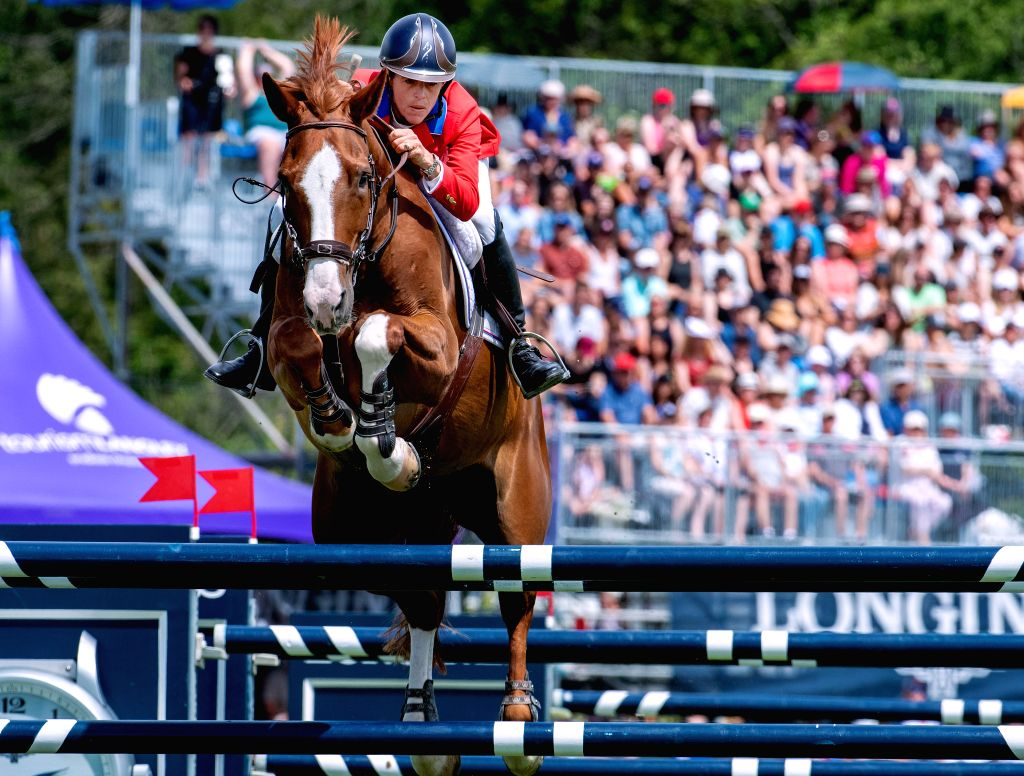 LANGLEY, June 3, 2019 - Jenni McAllister of the United States makes a jump during the game of FEI Nations Cup of Canada in Langley, Canada, June 2, 2019.