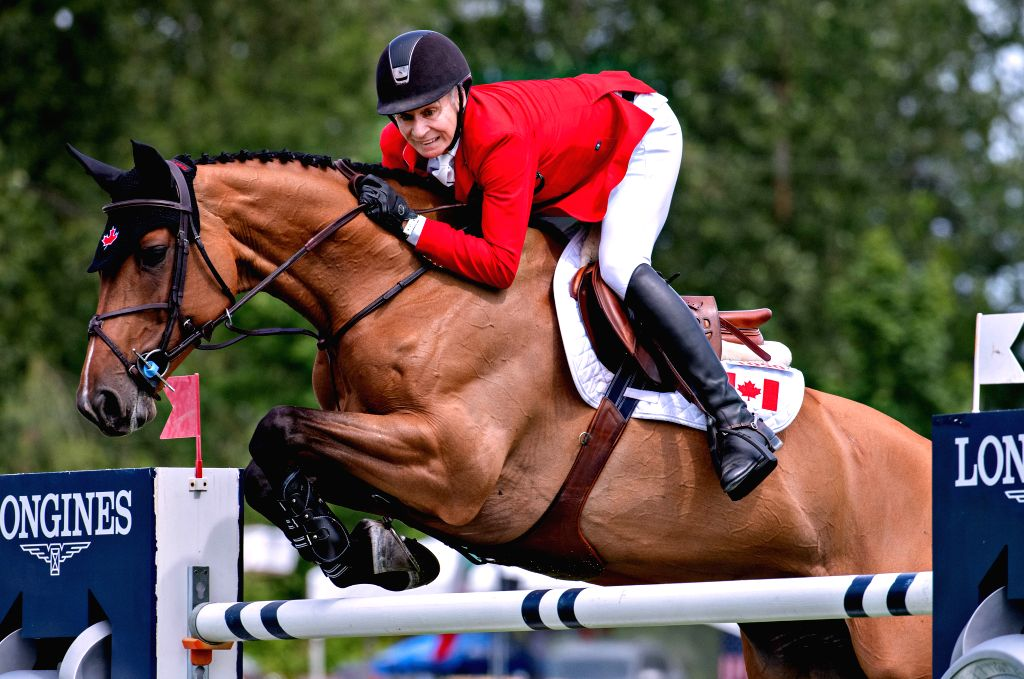 LANGLEY, June 3, 2019 - Mario Deslauriers of Canada makes a jump during the game of FEI Nations Cup of Canada in Langley, Canada, June 2, 2019.