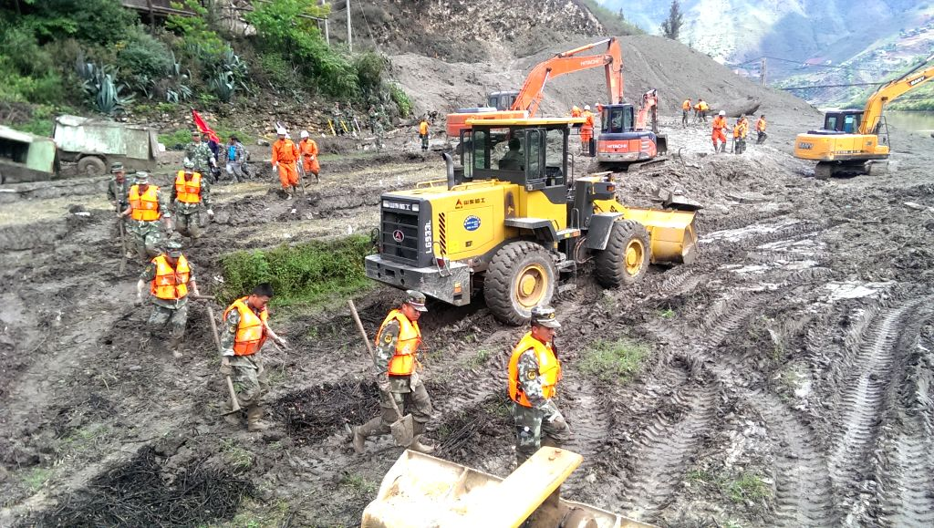 LANPING, April 23, 2016 - Rescuers work at the site of landslide in Guoli Village of Lanping County in Nujiang Lisu Autonomous Prefecture, southwest China's Yunnan Province, April 23, 2016. Six ...