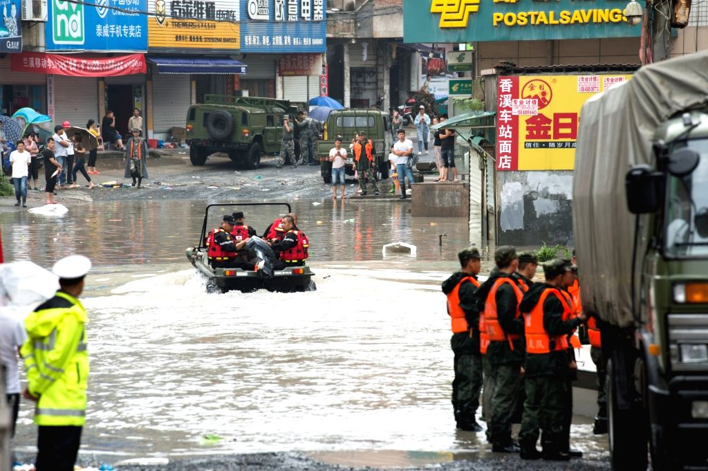 LANXI, June 26, 2017 - Rescuers ride an amphibious vehicle to the flood affected area in Xiangxi Township in Lanxi City, east China's Zhejiang Province, June 26, 2017. Influenced by continuous ...