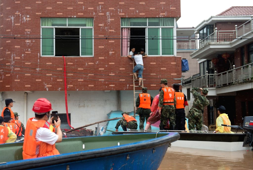 LANXI, June 26, 2017 - Rescuers transfer affected people in Xiangxi Township in Lanxi City, east China's Zhejiang Province, June 26, 2017. Influenced by continuous rainfall, a tributary of Lanjiang ...