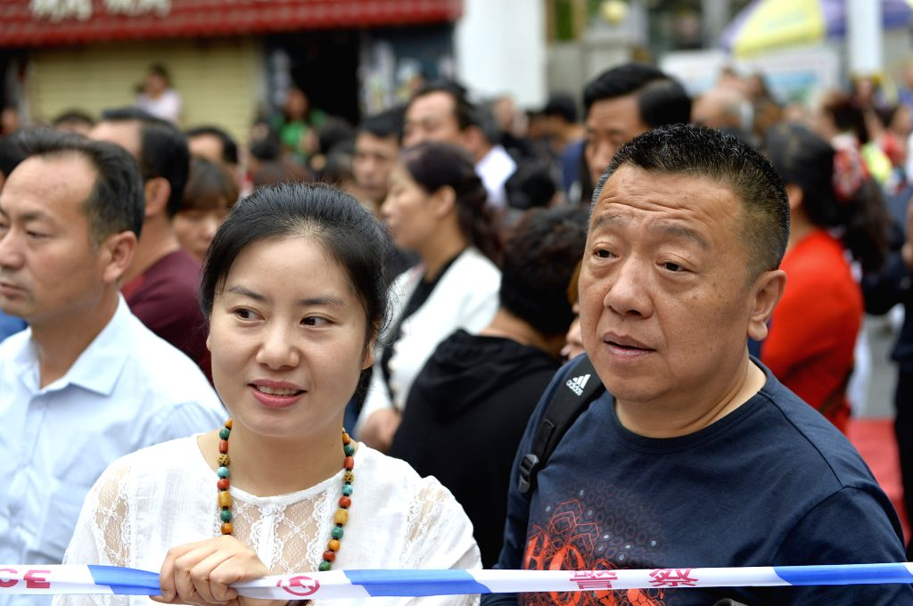 LANZHOU, June 7, 2018 - Parents of examinees wait at an exam venue in Lanzhou, capital of northwest China's Gansu Province, June 7, 2018. About 9.75 million students have registered for the national ...