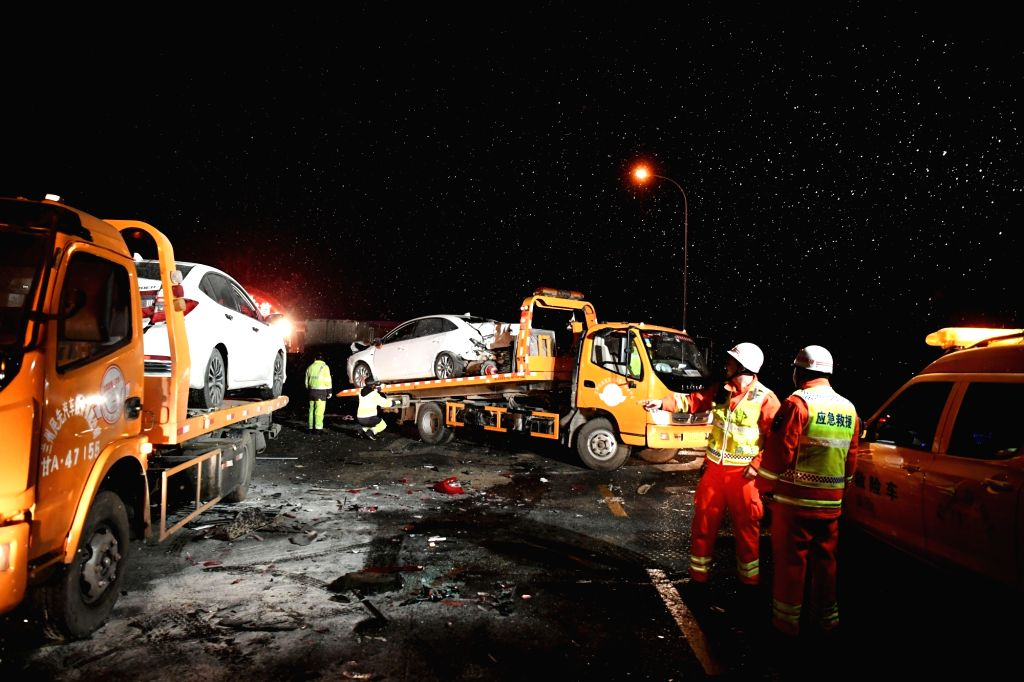 LANZHOU, Nov. 4, 2018 - Rescuers work at a traffic accident site at the Lanzhou south toll station on the Lanzhou-Haikou Expressway in Lanzhou, capital of northwest China's Gansu Province, Nov. 3, ...