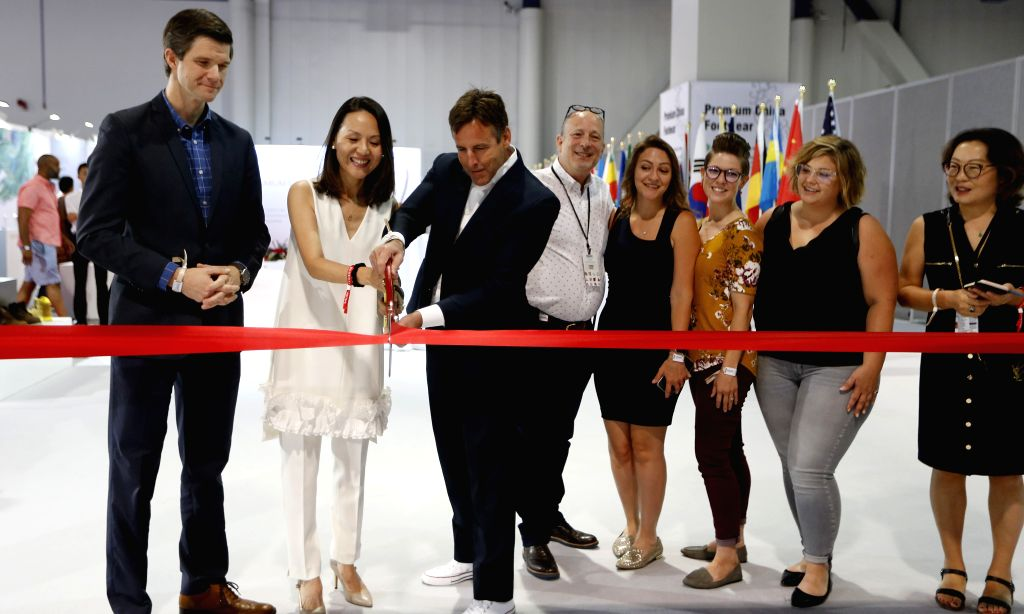 LAS VEGAS, Aug. 13, 2019 - Guests cut a ribbon at the opening ceremony of the China Footwear Pavilion at the Las Vegas MAGIC Show in Las Vegas, the United States, on Aug. 12, 2019. As one of the ...