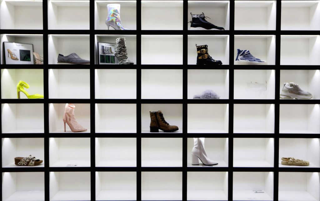 LAS VEGAS, Aug. 13, 2019 - Shoes are displayed at the China Footwear Pavilion at the Las Vegas MAGIC Show in Las Vegas, the United States, on Aug. 12, 2019. As one of the largest and most influential ...