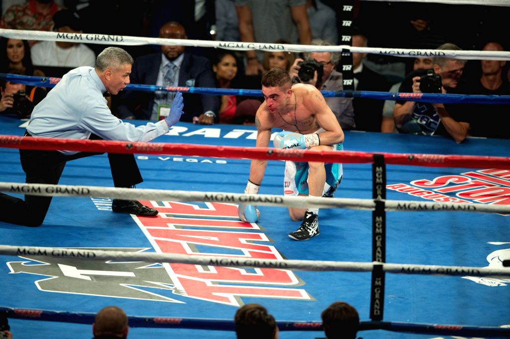 LAS VEGAS, July 24, 2016 - Matias Rueda (R) of Argentina receives a count after being knocked down by Oscar Valdez Jr. of Mexico during the vacant WBO featherweight title boxing match in Las Vegas, ...