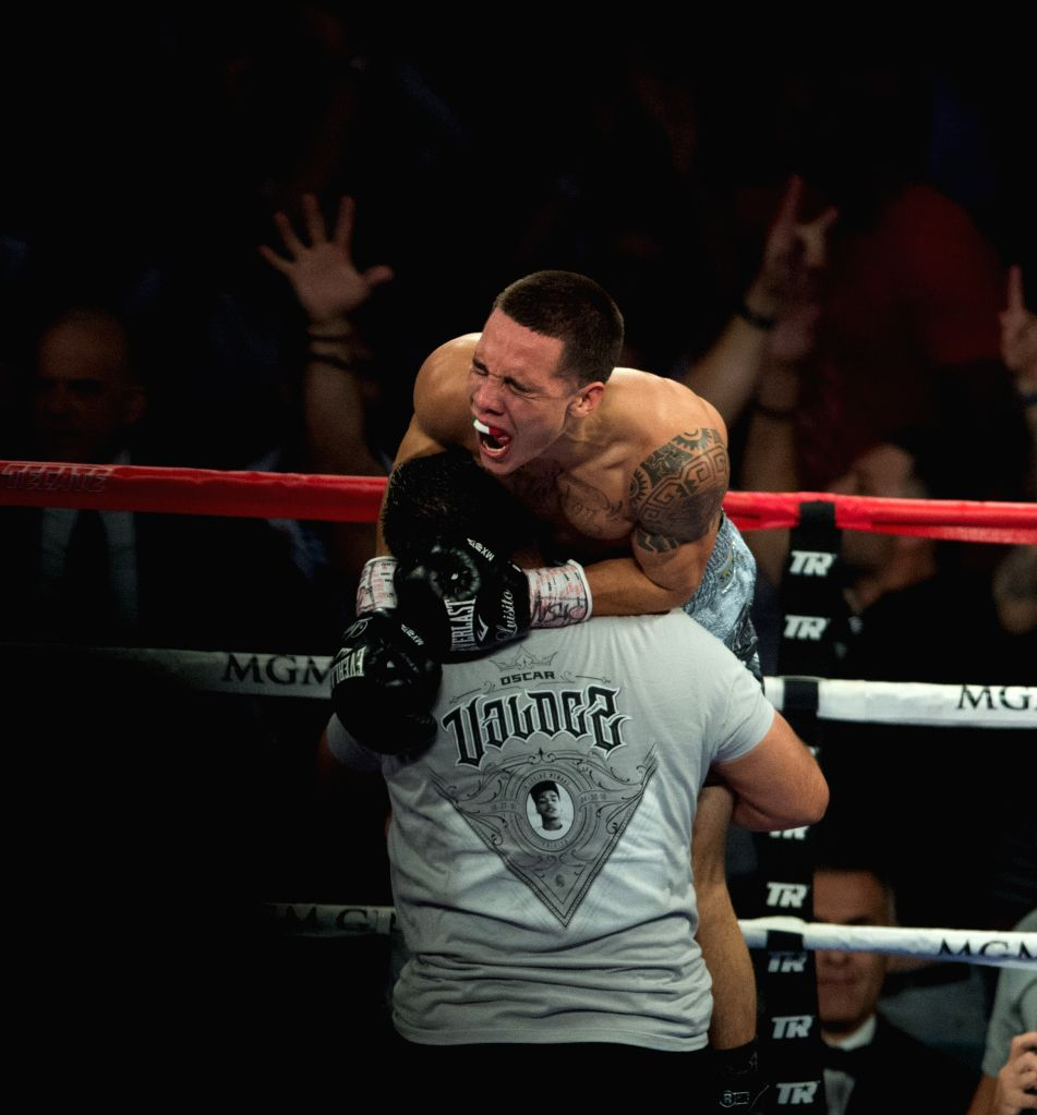 LAS VEGAS, July 24, 2016 - Oscar Valdez Jr. (Top) of Mexica celebrates after defeating Matias Rueda of Argentina during the vacant WBO featherweight title boxing match in Las Vegas, the United ...