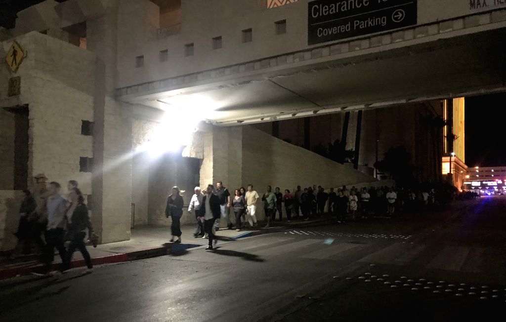 LAS VEGAS, Oct. 2, 2017 - People evacuate after the shooting in Las Vegas, the United States, Oct. 2, 2017. At least 50 people were killed and over 200 others wounded in a mass shooting at a concert ...