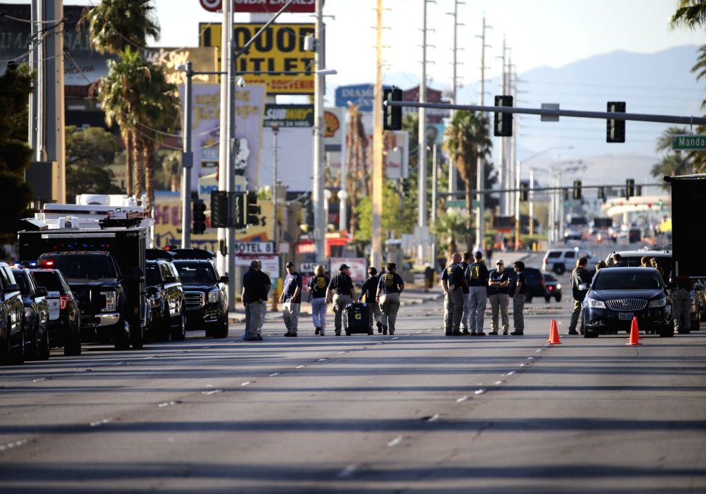 LAS VEGAS, Oct. 4, 2017 - Investigators gather by the shooting scene in Las Vegas, the United States, Oct. 3, 2017. At least 59 people were killed and 527 others wounded after a gunman opened fire ...