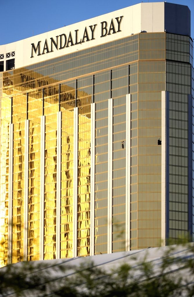 LAS VEGAS, Oct. 4, 2017 - Photo taken on Oct. 3, 2017 shows the broken windows of Mandalay Bay Hotel in Las Vegas, the United States. At least 59 people were killed and 527 others wounded after a ...