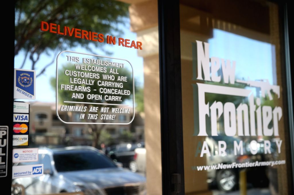 """LAS VEGAS, Oct. 5, 2017 - Photo taken on Oct. 4, 2017 shows the front door of a gun shop with a sign """"criminal are not welcome in this store"""" in Las Vegas, the United States. In the wake of ..."""