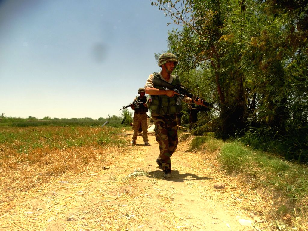LASHKAR GAH, June 18, 2016 - Soldiers take part in a military operation in Marjah district of Helmand province, Afghanistan, June 18, 2016.