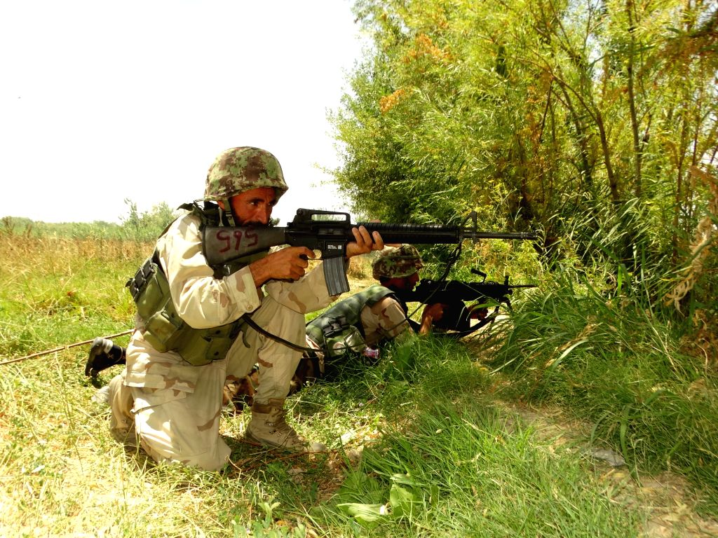 LASHKAR GAH, June 18, 2016 - Soldiers take position during a military operation in Marjah district of Helmand province, Afghanistan, June 18, 2016.