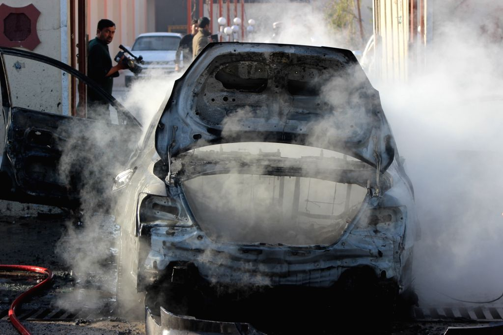 LASHKAR GAH, March 12, 2019 - A burnt car is seen after a blast in Lashkar Gah, capital of Helmand Province, south Afghanistan, on March 12, 2019. A local journalist was seriously wounded in a bomb ...