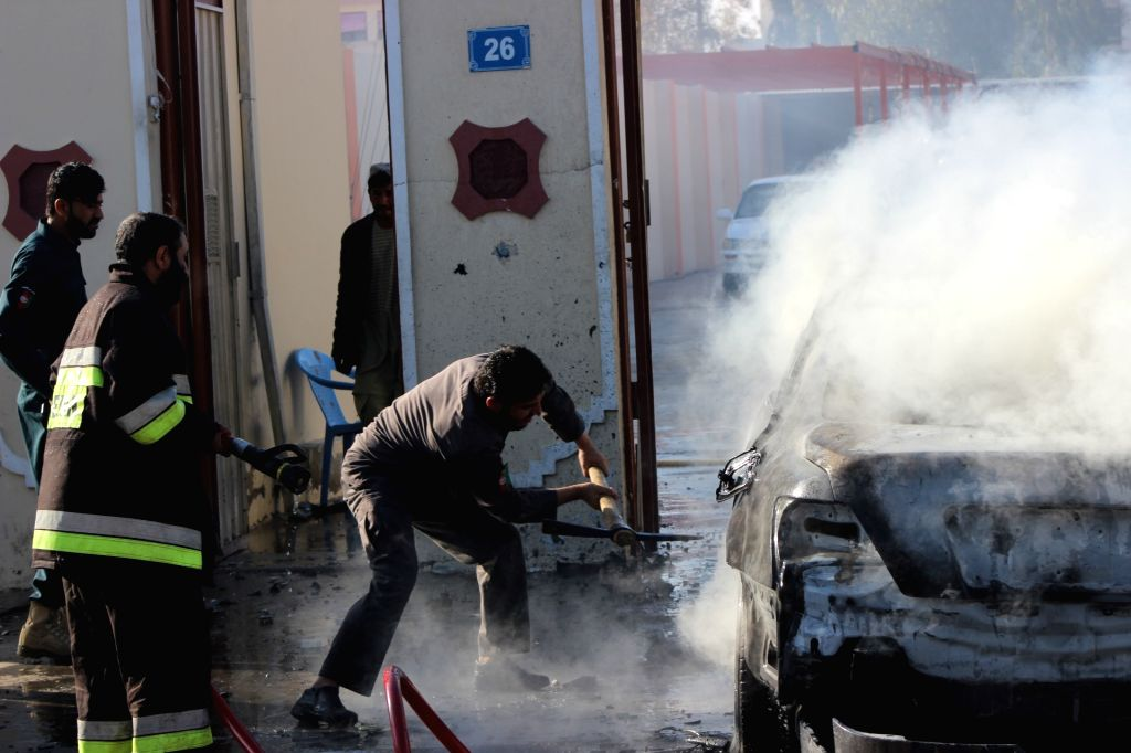 LASHKAR GAH, March 12, 2019 - A man tries to open a burnt car's door after a blast in Lashkar Gah, capital of Helmand Province, south Afghanistan, on March 12, 2019. A local journalist was seriously ...