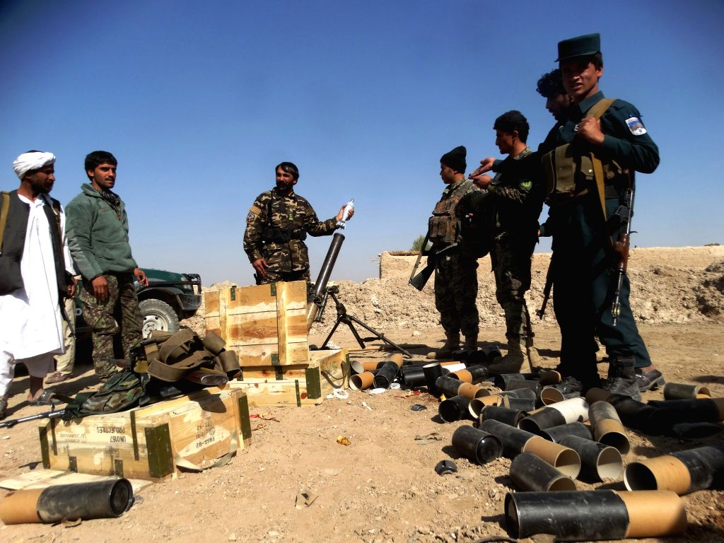 LASHKAR GAH, Oct. 22, 2016 - Afghan security force members take part in a military operation in Lashkar Gah of Helmand province, Afghanistan, Oct. 22, 2016. Afghan government forces expelled Taliban ...