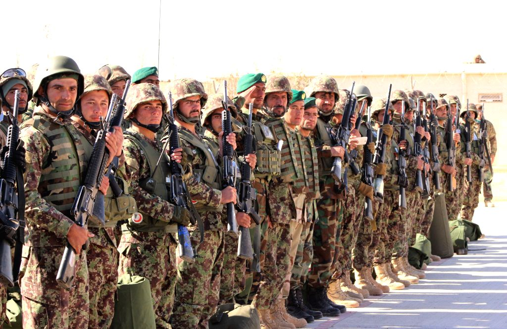LASHKARGAH, Dec. 4, 2017 - Afghan army soldiers take part in their graduation ceremony in Helmand, southern Afghanistan, Dec. 3, 2017. A total of 500 youths after completion of an eight-week training ...