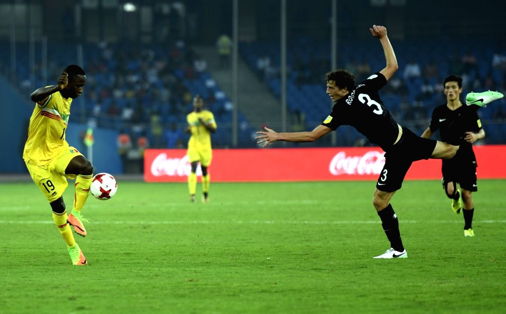 Lassana Ndiaye (Yellow Jersey No-19) of Mali and Kieran Richards (Black Jersey No - 3)  of New Zealand in action during a FIFA U-17 World Cup Group A match between Mali and New Zealand at ...
