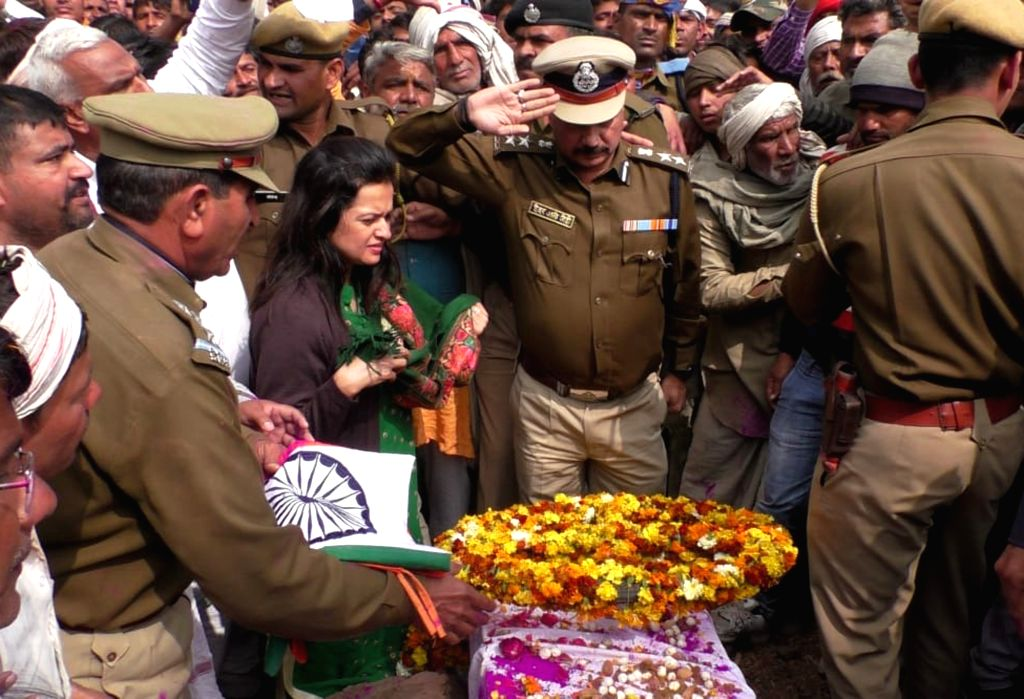 Last rites of martyr Jeet Ram, one of the 49 CRPF personnel killed in 14 Feb Pulwama militant attack underway at Rajasthan's Bharatpur on Feb 16, 2019.