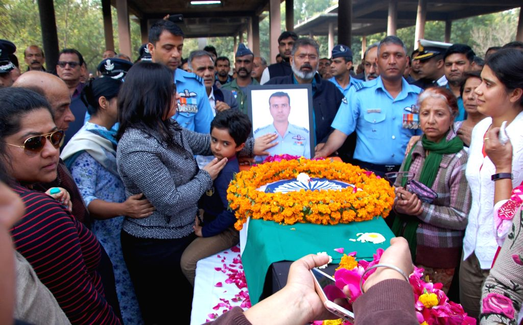 Last rites of Wing Commander Sahil Gandhi, who died while practicing for Aero India 2019 - air show underway in Hisar, Haryana on Feb 21, 2019. - Commander Sahil Gandhi