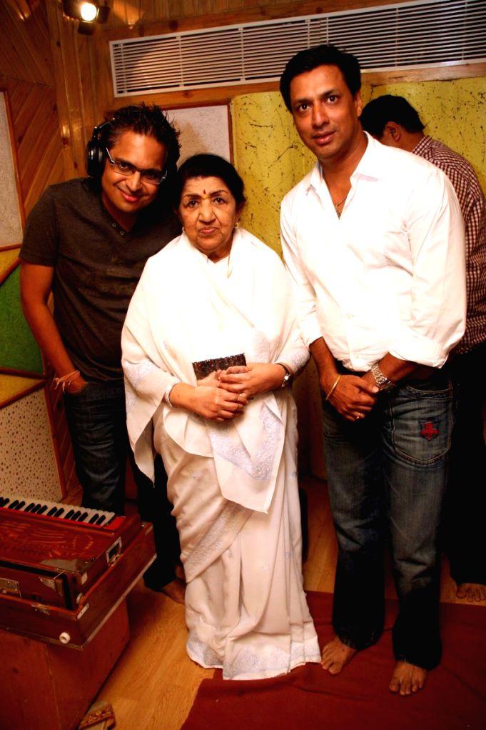 Lata Mangeshkar records a track for Madhur Bhandarkar's film Jail .