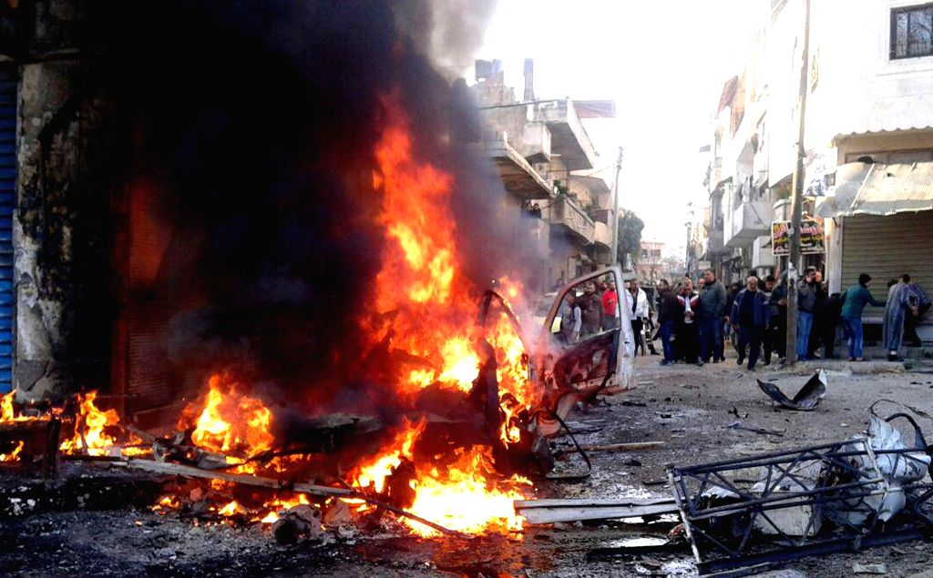 LATAKIA, Jan. 22, 2019 - A burning vehicle is seen at the site where a car bomb exploded in Latakia, Syria, on Jan. 22, 2019. A booby-trapped pickup truck went off in Syria's northwestern city of ...