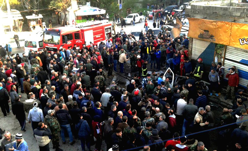 LATAKIA, Jan. 22, 2019 - People gather at the site where a car bomb exploded in Latakia, Syria, on Jan. 22, 2019. A booby-trapped pickup truck went off in Syria's northwestern city of Latakia on ...