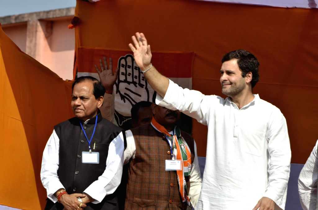 Congress Vice President Rahul Gandhi waves to the crowd during an election rally ahead of Jharkhand Assembly Elections at Manika in Lathehar district, about 140 kms from Ranchi, Jharkhand ..