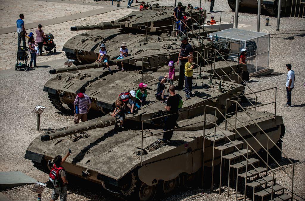 Visitors are seen around a Merkava Main Battle Tank I (Bottom), Merkava Main Battle Tank II (C) and Merkava Main Battle Tank III at Yad La'shiryon Latrun, memorial .