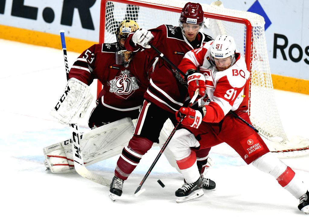 LATVIA, Nov. 15, 2019 - Mikhail Yunkov (R) of Moscow Spartak vies with Kristofer Berglund (C) of Riga Dinamo during the 2019-2020 Kontinental Hockey League (KHL) ice hockey match in Riga, Latvia, ...