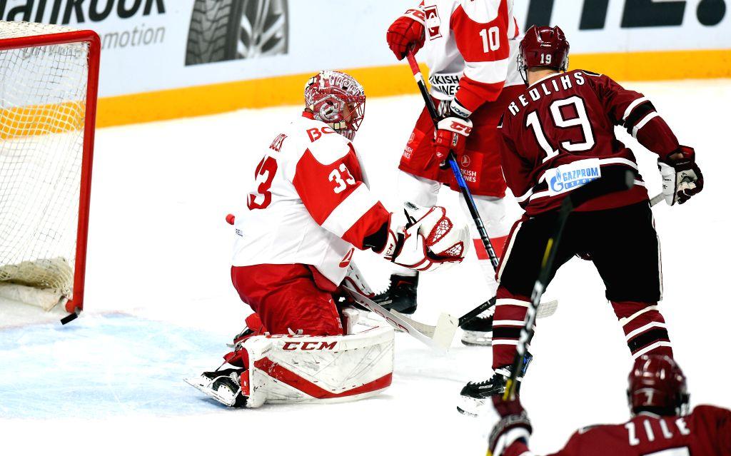 LATVIA, Nov. 15, 2019 - Moscow Spartak's goalkeeper Julius Hudacek (L) fails to block a goal during the 2019-2020 Kontinental Hockey League (KHL) ice hockey match against Riga Dinamo in Riga, Latvia, ...