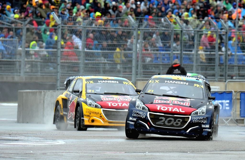 LATVIA, Sept. 16, 2019 - Kevin Hansen (L) and Timmy Hansen (R) of Sweden compete during the semifinal race of the Neste World RX of Latvia in Riga, Latvia, Sept. 15, 2019.