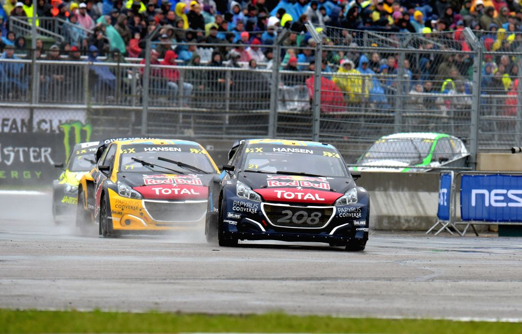 LATVIA, Sept. 16, 2019 - Timmy Hansen (front) of Sweden competes during the semifinal race of the Neste World RX of Latvia in Riga, Latvia, Sept. 15, 2019.
