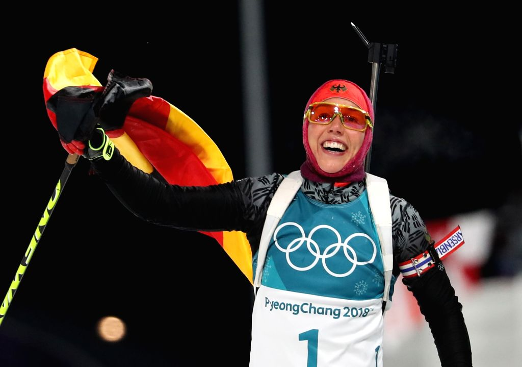 Laura Dahlmeier of Germany celebrates after winning the gold in the 10km women's biathlon pursuit finals at the PyeongChang Winter Olympics at Alpensia Biathlon Centre in Pyeongchang, ...
